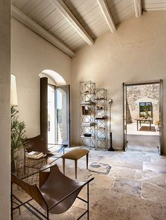 """On the plain of Noto, a farmhouse becomes a refuge and workshio for Antonino Sciortino and Maurizio Zucchi, with a chic, minimalist mood that rediscovers spontaneous """"noble"""" forms suspended between past and present Interior Styling, Interior Design, Home Coffee Tables, Loft, Minimalist Home Decor, Mediterranean Homes, Modern Rustic Interiors, Rustic Farmhouse, Living Area"""