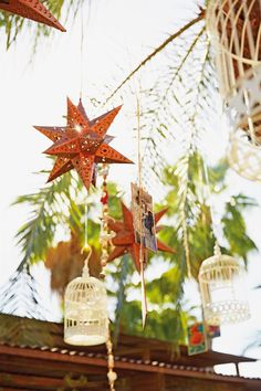 Birdcages and star lanterns hang from the palm trees at Flora Farm in Cabo, Mexico. Pic by Squire Fox