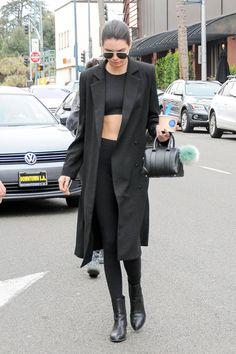 In a black crop top, leggings, coat and mini Givenchy bag.    - HarpersBAZAAR.com