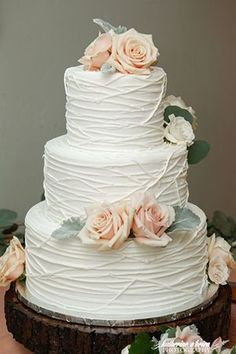 three tiers buttercream pink floral wedding cakes