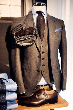 Brown check 3 piece suit accessorized with a brown tie, woven belt & double buckle oxfords. The powder blue shirt adds a pleasant element of surprise.  #lookbook #lookoftheday #fashion   www.amaa-fashion.com