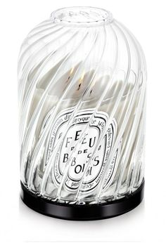 Large Photophore Complete Twist The Large Photophore Collection features two mouth-blown, hand-crafted candleholders sold separately. The globe made of borosilicate glass, a heat resistant material. On a classic candle stand made of black Bakelite. diptyque standard candles sold separately.