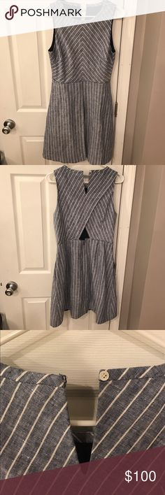 J.Crew Chambray Stripe Dress Very flattering fit and flare dress with lower back peek-a-boo. Fabric hook at the top in back is missing thread but this would be an easy fix. Zip closure at waist area. Lining is a sheer navy fabric. Interested in offers but not looking for trades J. Crew Dresses