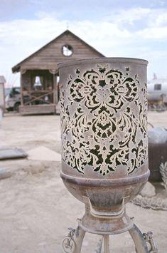 Laser cut from and old milk jug, I'm guessing some kind of lantern from Ponoko Blog, image taken at Burning Man