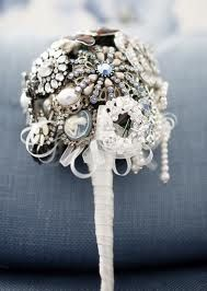 Broach bouquet---I HAVE to have one of these when I get married. I want one with real flowers too though.