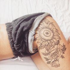 Floral tattoo. Thigh tattoo. Feminine tattoo. Kowhai leaves. Kowhai leaves tattoo. Tattoo. Girly tattoo. Sunflower tattoo. Rose tattoo. Line work tattoo. Dot tattoo.
