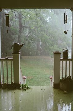 Sitting on a porch, watching the rain.