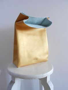 Golden leather paper bag. I LOVE this!!