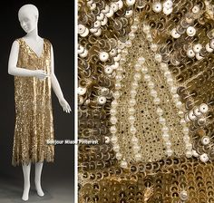 Evening dress, Paris, circa 1920s. Silk or rayon net embroidered with gold crimped-edge sequins, faux pearls, and glass beads. via Historic Deerfield.