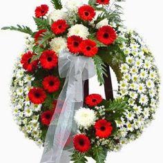 Enviar corona funeral Buena Suerte formada por Gladiolos y lirios. Desde nuestra floristería del tanatorio servimos coronas funerarias urgente.