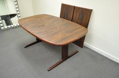 Mid-Century Danish Modern Rosewood Dining Table with Two Leaves by Skovby   From a unique collection of antique and modern dining room tables at https://www.1stdibs.com/furniture/tables/dining-room-tables/