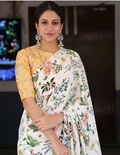 White floral saree paired with yellow floral blouse for festivals Indian Dresses, Indian Outfits, Floral Print Sarees, Printed Sarees, Floral Blouse, Modern Saree, Saree Dress, Sari Blouse, Blouse Neck