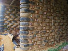 "The recycled house design called ""earthship"" is a ""green project"" and designed by biotecture in Taos, New Mexico, United States. Materials that used in this construction are used car tires, empty plas (Bottle Garden Wall) Natural Building, Green Building, Building A House, Recycled House, Recycled Tires, Earthship Home, Earthship Design, House Foundation, Tyres Recycle"