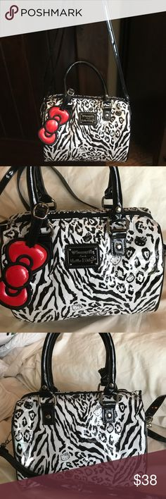 Adorable Loungefly Hello Kitty bag/purse Super cute Hello Kitty bag by Loungefly! Never used, in excellent condition! Can be used different ways as it has handles and a shoulder strap. All of my items ship quickly from a smoke free home. Thanks for looking. Loungefly Bags