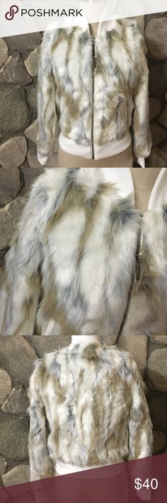 • White mixed 100% vegan fur jacket • Brand new. Shell: 57% acrylic 43% polyester. Lining: 100% polyester. Gorgeous faux fur. Two pockets on the front. Color: white, grey and brown tones. No trades Jackets & Coats Utility Jackets