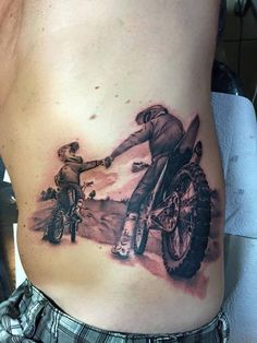 Motor cycle tattoo of father and son.  it