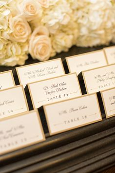 Elegant escort cards lined with gold