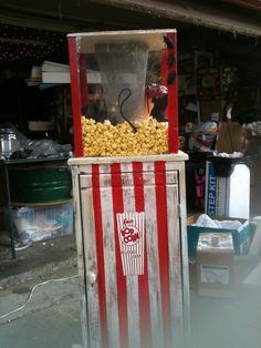 Homemade popcorn dispenser.... I think I'd make the stripes the width of duct tape, so I'd be able to use white tape to cover the worn look for a non-scary circus theme.