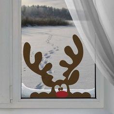 Vinilo decorativo de reno en la ventana