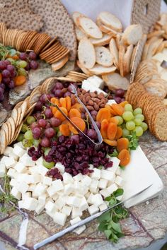 Dried Apricots, Cranberries, Almonds, Grapes, Crackers, Crostini, Cheese