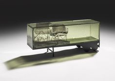 """Jeremy Lepisto Local reserves 5.125"""" d x 20"""" l x 8.5"""" h Kilnformed glass and fabricated steel 2013"""