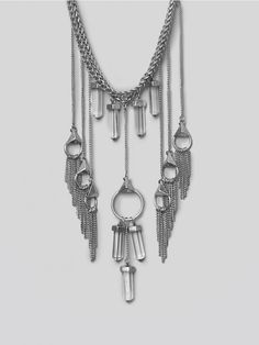 8 OTHER REASONS Become the life of the party in this chucky statement-piece. Silver tone necklace, featuring a double-layer chain, lobster clasp closure and adorned with hanging crystals, studs and chains. There's no need to add any additional accessories - this piece speaks for itself.
