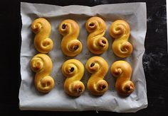 13 the Scandinavian countries celebrate St. Lucia day with special saffron buns called Lussekatter or Lussebullar. St Lucia Day, St. Lucia, Saint Lucia, Swedish Christmas Food, Pearl Sugar, Bun Recipe, Egg Wash, Swedish Recipes, Play Dough