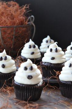Ghost Cupcakes | Ghost Cupcakes. DIY Halloween dessert. Kids can help with chocolate chip eyes and mouth. Party or classroom snack.