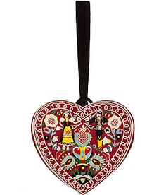 Exquisite hand embroidery lends a folkloric look to this suede trimmed heart clutch from Olympia Le-Tan #Stylebop