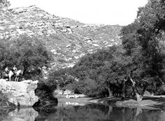Robin Hood Lake at the back of Corriganville Movie Ranch was used for stunt shows and was a place where the public could picnic, and ride paddle boats and canoes. The two horse riders are on stunt rock which was also used in Tarzan movies.