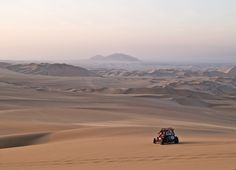 Take a buggy ride across the dunes of the Ica desert, Peru