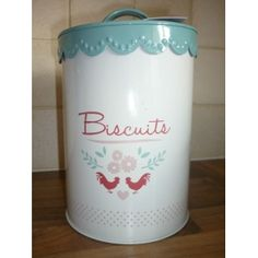 We love this brand new retro enamelware range from Gisela Graham! Perfect for your homemade biscuits and cookies, this enamelware biscuit barrel will add a touch of style to your country kitchen! Duck egg blue lid, white tin body, and detailed red chickens. Co-ordinating items available. Measures: 14cm diameter x 18.5cms high.