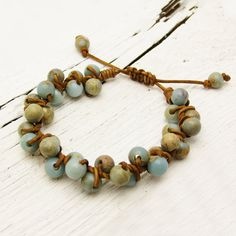 African Opal Leather Bracelet with Macrame Adjustable Closure: blue white rustic knotted sky bohemian organic earth tones round chunky. $52.00, via Etsy.