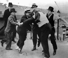 """Today in labor history, May 26, 1937: Ford security attack union organizers and supporters attempting to distribute literature outside the plant in Dearborn, MI. They then tried to destroy the pictures photographers had taken that documented the attack, which became known as the """"Battle of the Overpass."""" The photos that survived inspired the Pulitzer committee to establish a prize for photography."""