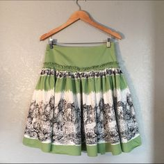 Anthropologie Odille French Village Sketch Skirt Anthropologie brand Odille green cotton full skirt. Featuring artistic sketch of a quaint French village scene and ruffle detail at the hips. Fully lined, gently used condition. No defects or stains noted. Anthropologie Skirts A-Line or Full