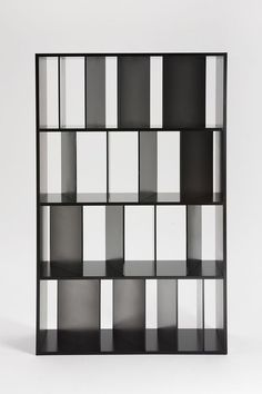 Japanese studio Nendo's new 'Sundial' bookcase for Kartell, whose variously angled vertical dividers play with light and shadow
