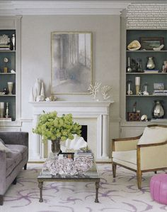 White around fireplace, tall above fireplace draws eye up, color behind book shelves, cabinets below