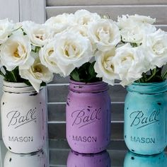 Dress up - and distress up - your mason jars for Spring with some latex paint and a nail file.