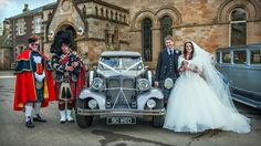 The beautiful bride and her new husband with two of Pipers!  www.elitebands.co.uk
