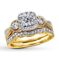 A round diamond complements both sides of the center stone in this stunning engagement ring with matching wedding band. Wedding Rings Sets Gold, Diamond Wedding Sets, Matching Wedding Bands, Gold Wedding, Bridesmaid Accessories, Bridesmaid Jewelry Sets, Bridal Jewelry Sets, Kay Jewelers Bridal Sets, Bridal Bracelet