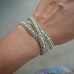 This triple wrap bracelet made with plated metal beaded and plated chain. Create a stylish layered look by pairing with your favorite silver and gold tone cuffs and bangles. {{ Product Detail }} ✧ Length : 50cm with adjustable. ✧ Closure : Button ✧ Fits a 6 to 7 inch wrist wrapped 3 times.