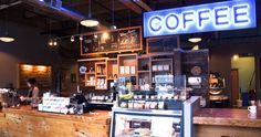 Portland OR: The Water Avenue Coffee factory creates handcrafted coffees in Portland's Southeast Industrial district. The large blue neon COFFEE sign glows all night long as a beacon to travelers on nearby I-5.