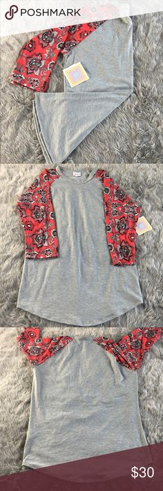 LuLaRoe Randy Shirt I received it as a present and it honestly doesn't fit me :( LuLaRoe Tops Tees - Short Sleeve