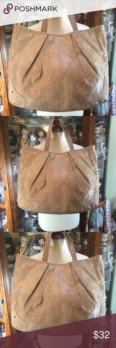 Chico's large tote NWOT Beautiful Chico's large snake skin looking tote.  This bag is large and in a dark beige color. Appears to be new crisp inside and out. Nice bag that will go with almost anything. Chico's Bags Totes