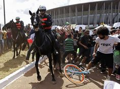 Activists and students scuffle with riot police outside the Mane Garrincha National Stadium in Brasilia, on June 15, 2013. (Reuters/Ueslei Marcelino)
