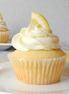 Raspberry Filled Lemon Cupcakes with white choco cheese cake raspberry buttercream