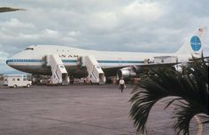 Pan Am 747-100 in Manila c.1970, would be one of first flights with 747 given the small Clipper ship name and livery. Looks like they opened the emergency hatch top of the cockpit.