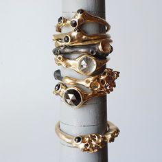 stack by johnnyninos, via Flickr - oxidized silver - 10k & 14k gold - black diamonds & white sapphire