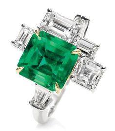 Emerald flanked by modern diamonds