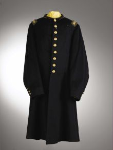 """Frock Coat of 2nd Lieutenant Solon Finney, Co E, 6th Michigan Cavalry.  Officer's custom-made uniform with a yellowish velvet lay down collar, and US Cavalry eagle """"C"""" buttons .The 2nd Lt. shoulder straps have a cavalry yellow velvet background with dead and bright borders. He was mortally wounded by a gunshot wound to the chest at Bethel Church, Virginia near Amelia Courthouse, and died on April 9, 1865, the very day that Lee surrendered the army of northern Virginia to Grant at Appomattox."""